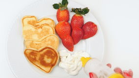 Valentine`s day breakfast. Breakfast of pancakes, straberries, cream and coffe for Valentine`s day stock footage