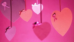 Valentine`s Day Bunch Of Hearts Swinging. Pink colour stock video