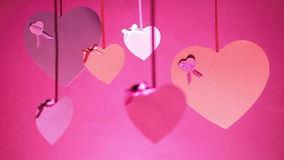 Valentine`s Day Bunch Of Hearts Swinging stock video