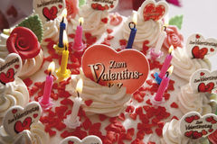 Valentine's day cake with burning candles, close-up Stock Photos