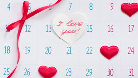 Valentine`s day on calendar page stock footage