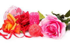 Valentine's day. Candles, roses and gift box isolated on white background Stock Photos