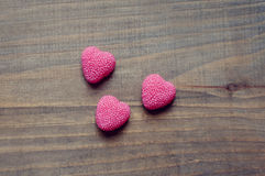Valentine's Day candy hearts on a wooden background. Valentine's Day hearts on a wooden background stock photography