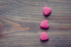 Valentine's Day candy hearts on a wooden background. Valentine's Day hearts on a wooden background stock photos