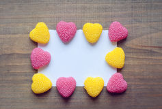 Valentine's Day candy hearts on a wooden background. Valentine's Day hearts on a wooden background stock photo