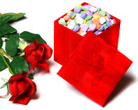 Valentines Day candy and red roses Stock Photos