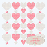 Valentine's Day Card. Background of hearts knitted. Card of pink and beige hearts   with tag Valentine's Day Royalty Free Stock Photo