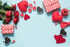 Valentine`s day greeting card. Composition with gifts, roses, red hearts on blue surface. Top view. Copy space. Valentine`s day card. Composition with gifts Royalty Free Stock Photo