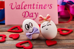 Valentine`s Day card, eggs, hearts. Faced eggs with bow ties. How to make cute present stock photo