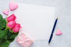 Valentines Day card with empty list of paper, roses, and pen. Happy Valentines Day greeting card with empty list of paper, pink roses, gift box, heart shaped stock image