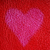 Valentine's day card. Heart love symbol on red leather background Stock Photos