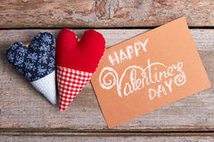 Valentine`s Day card and hearts. Fabric hearts on wooden background. The magic of love Stock Photo