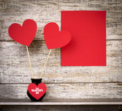 Valentine`s Day card with hearts on sticks in vase. Royalty Free Stock Images