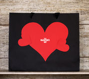Valentine`s Day card with paper hearts and gift bags. Royalty Free Stock Photos