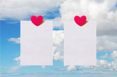 Valentine's Day card with sky background. Pattern for Valentine's Day card with sky background and white sheet of paper held by heart shaped pin Stock Photos