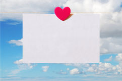 Valentine's Day card with sky background. Pattern for Valentine's Day card with sky background and white sheet of paper held by heart shaped pin Royalty Free Stock Photo
