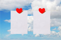 Valentine's Day card with sky background. Pattern for Valentine's Day card with sky background and white sheets of paper held by heart shaped pin Royalty Free Stock Photo