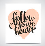Valentine's  Day Card with stylish Love lettering Follow your heart. Vector illustration. Stock Photos