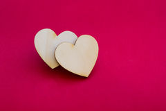 Valentine's day card with two wooden hearts symbol on red surfac Stock Photography