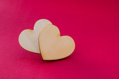 Valentine's day card with two wooden hearts symbol on red surfac Stock Image