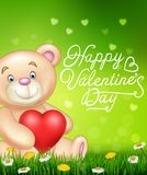 Valentine`s day with Cartoon bear holding red heart balloons on green grass Royalty Free Stock Photo