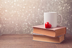 Valentine's day celebration with cup and heart on books Royalty Free Stock Image