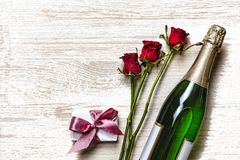Valentine`s Day. Valentine`s Day. Champagne, gift box and red roses. Layout. Free space for text. Birthday, Wedding, Mother`s D Royalty Free Stock Photos