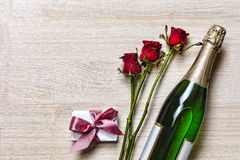 Valentine`s Day. Valentine`s Day. Champagne, gift box and red roses. Layout. Free space for text. Birthday, Wedding, Mother`s D Royalty Free Stock Photography