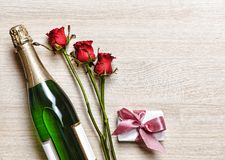 Valentine`s Day. Valentine`s Day. Champagne, gift box and red roses. Layout. Free space for text. Stock Photo
