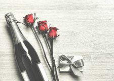 Valentine`s Day. Champagne, gift box and red roses. Layout. Free space for text. Royalty Free Stock Photos