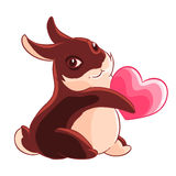 Valentine`s day. Chocolate Bunny holding a heart in his paws. Vector illustration Royalty Free Stock Image