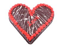 Valentine`s Day, Chocolate cake in the shape of a heart with the word love Stock Photography