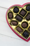 Valentine's Day Chocolates. Heart-shaped box of assorted chocolates Stock Images