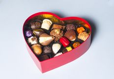 Valentine`s day. Chocolates in the shape of a heart stock images