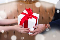 Valentine`s day or christmas concept - gift box in male and fema Royalty Free Stock Photo