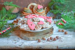 Christmas cookies in bowl. Valentine`s day or Christmas cookies in bowl. Gingerbread heart cookies on a wooden background stock photography