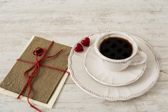 Valentine's day coffee set with greeting card. Valentine's day corree set with cup of coffee, red hearts and greeting card on wooden gray background Stock Photography