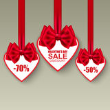 Valentine's day collection heart sale tag with bows Stock Photos