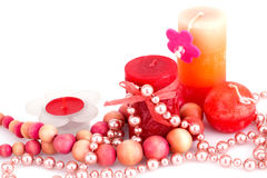 Valentine's day. Colorful candles and necklaces on white background Stock Photos