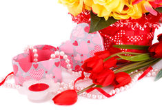Valentine's day. Colorful flowers, candle, beads and gift box close up picture Royalty Free Stock Photos