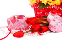 Valentine's day. Colorful flowers, candles and gift box close up picture Stock Photo