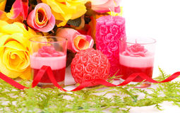 Valentine's day. Colorful flowers and candles on white background Stock Photos