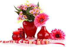 Valentine's day. Colorful flowers, vases, candles and necklaces on white background Stock Image