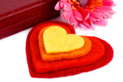 Valentine's day. Colorful hearts, daisy flower and gift box on white background Stock Photo