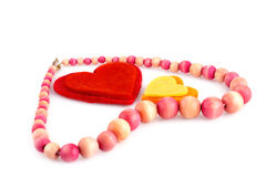 Valentine's day. Colorful hearts and wooden necklace on white background Royalty Free Stock Photography