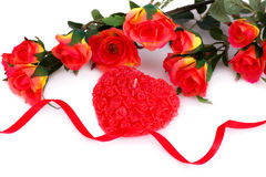 Valentine's day. Colorful roses, candle and ribbon on white background Royalty Free Stock Photos