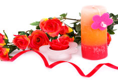 Valentine's day. Colorful roses, candles and ribbon on white background Royalty Free Stock Image