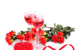 Valentine's day. Colorful roses, candles and ribbon on white background Stock Photos