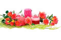 Valentine's day. Colorful roses and candles on white background Stock Photo
