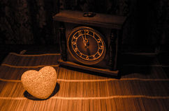 Valentine's Day composition with sweet burning multicolored heart on dark background and old vintage clock, time and love concept, Stock Photos